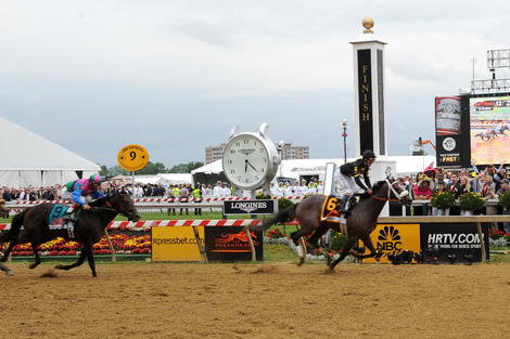 Longines Flat Racing Event: Longines awards luxury timepieces to owner, trainer and jockey of Preakness Stakes winner, Oxbow
