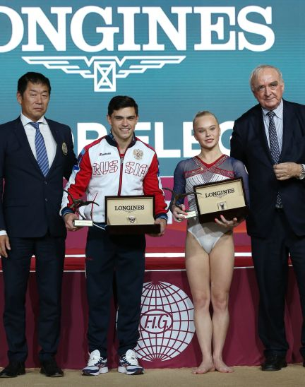 The Longines Prize for Elegance awarded to Russia's Angelina Melnikova and Russia's Artur Dalaloyan at the 48th Artistic Gymnastics World Championships in Doha