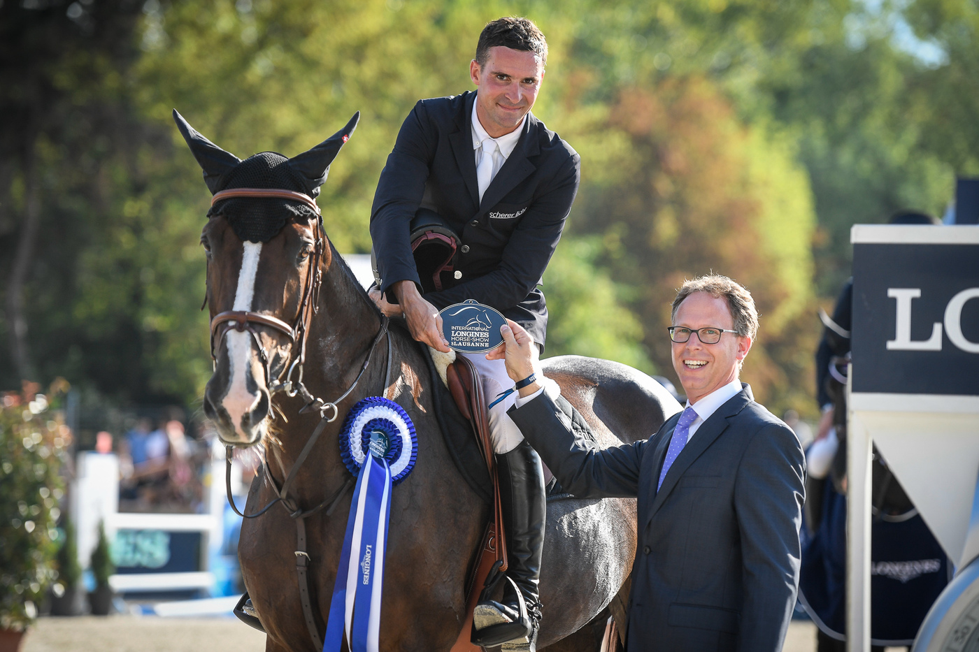 Longines Show Jumping Event: Robert Whitaker (GBR) wins the Grand Prix Longines of the City of Lausanne 5