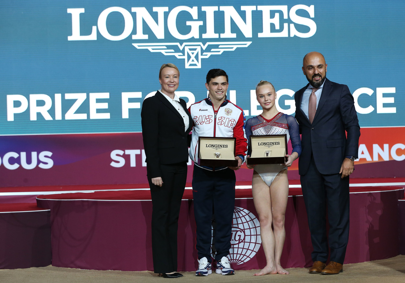 Longines Gymnastics Event: The Longines Prize for Elegance awarded to Russia's Angelina Melnikova and Russia's Artur Dalaloyan at the 48th Artistic Gymnastics World Championships in Doha 1