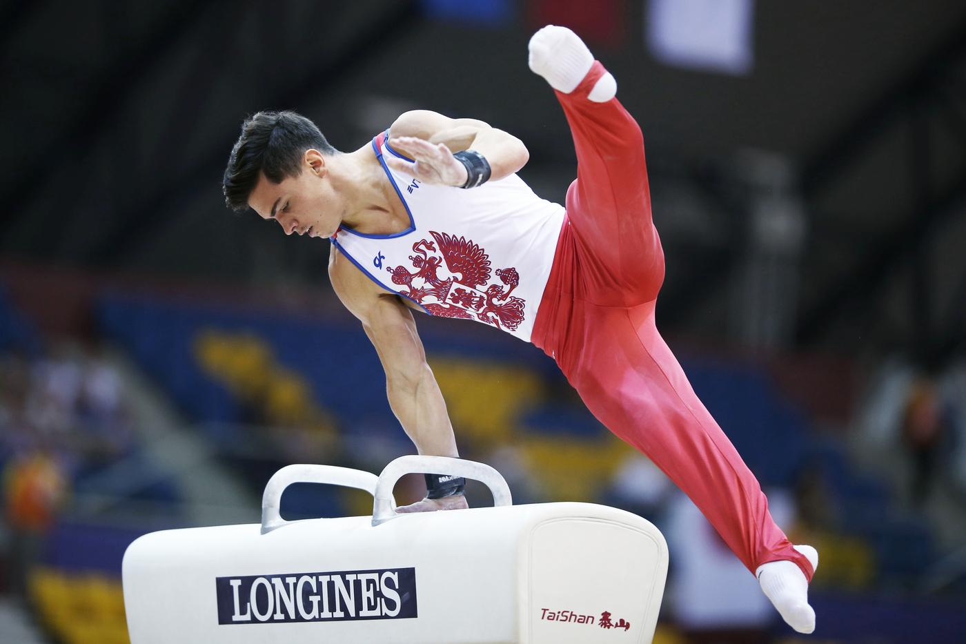 Longines Gymnastics Event: The Longines Prize for Elegance awarded to Russia's Angelina Melnikova and Russia's Artur Dalaloyan at the 48th Artistic Gymnastics World Championships in Doha 4