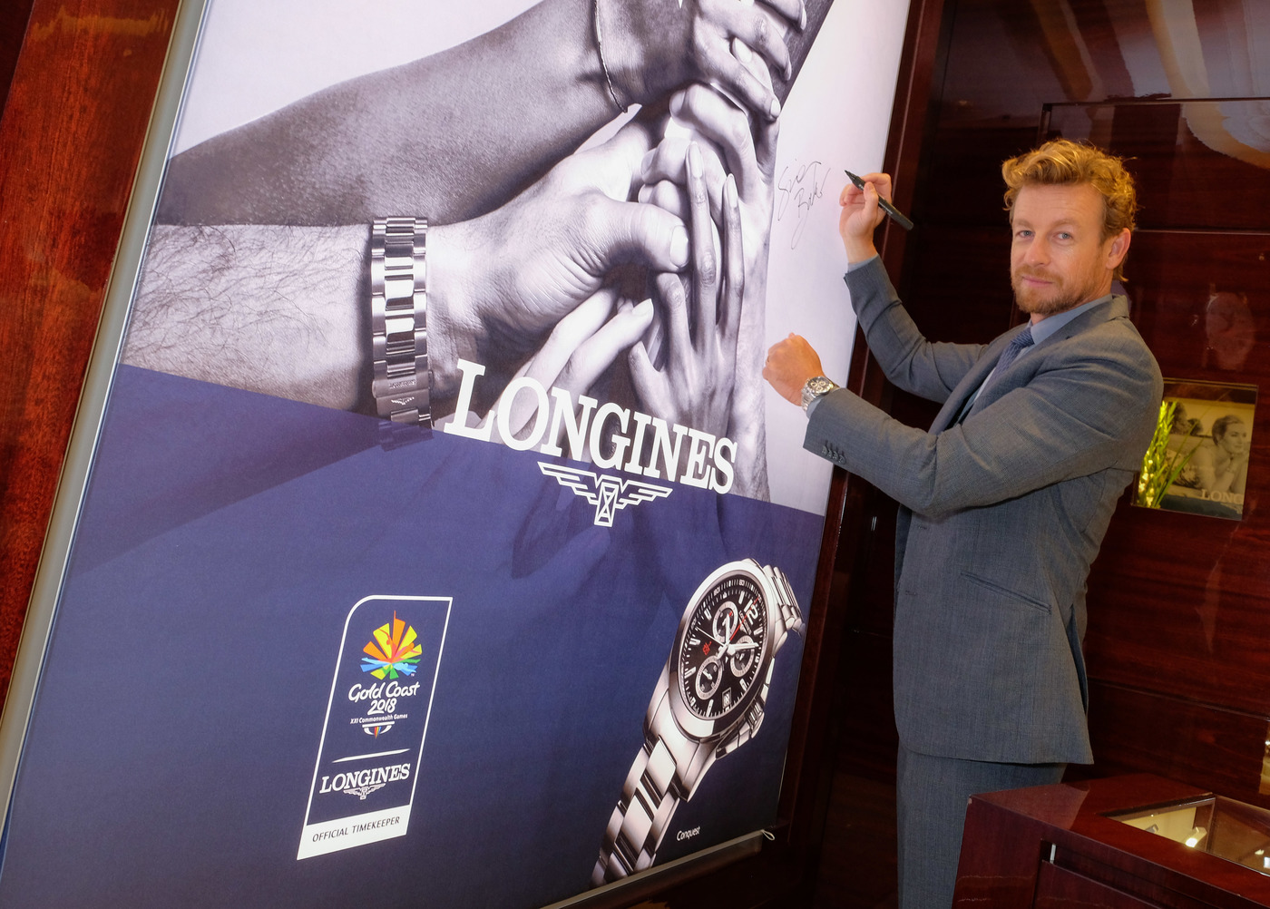 Longines Commonwealth Games Event: Longines Ambassador of Elegance Simon Baker welcomed the 2018 Commonwealth Games Queen's Baton in the Longines Boutique in London 2