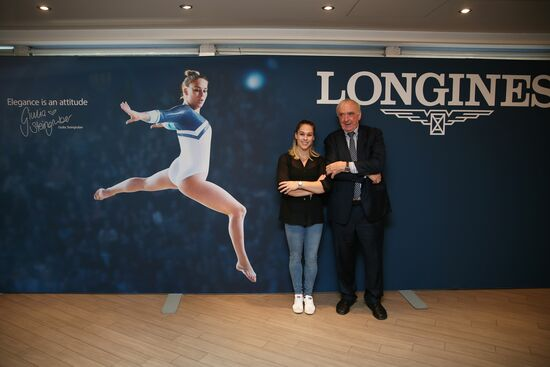 Longines Gymnastics Event: France's Melanie de Jesus dos Santos and USA's Samuel Mikulak were honored with the Longines Prize for Elegance at the 49th Artistic Gymnastics World Championships in Stuttgart 1